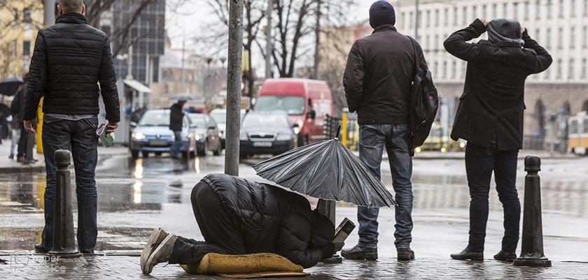Beggar in Street